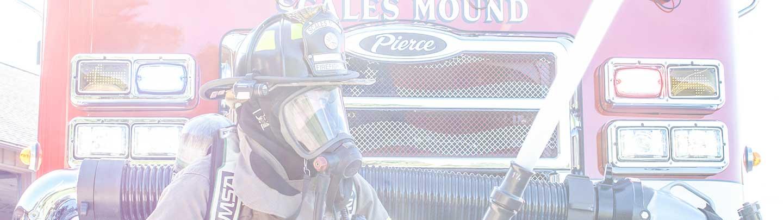 Firefighter spraying water.